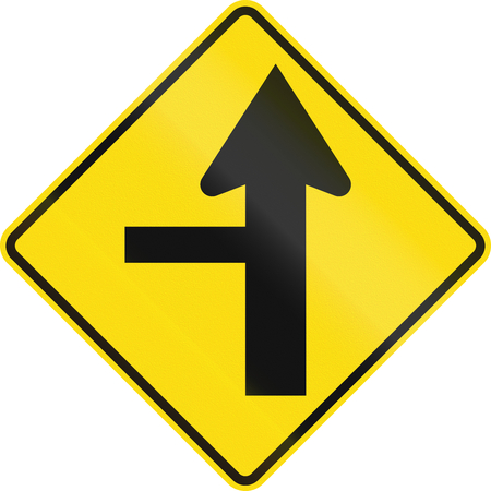 controlled: New Zealand road sign - Side road junction controlled on left. Stock Photo