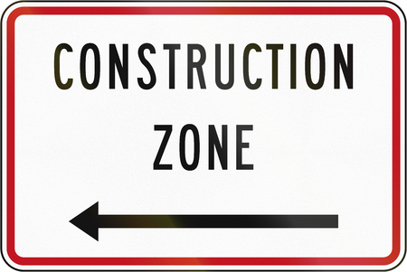 roadworks: New Zealand road sign - Construction zone (with arrow pointing left). Stock Photo