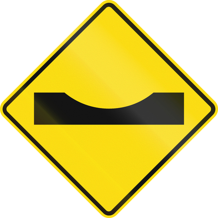 dip: New Zealand road sign PW-38 - Dip in road. Stock Photo