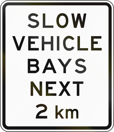 slow: New Zealand road sign - Slow vehicle bays for the next 2 kilometres.