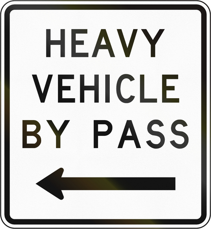 bypass: New Zealand road sign - Bypass for heavy vehicles, to left. Stock Photo