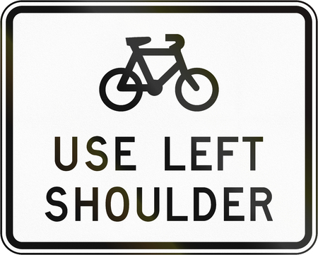 road shoulder: New Zealand road sign - Sign advising cyclist to use the left shoulder.