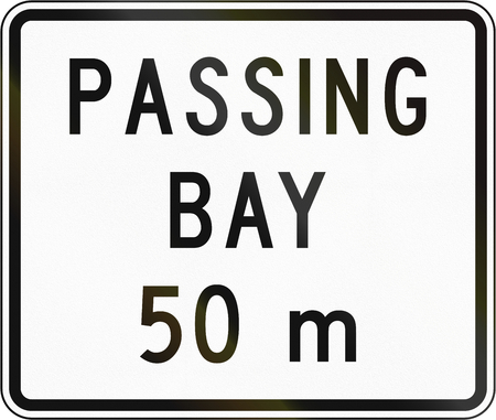 passing the road: New Zealand road sign - Passing bay ahead in 50 metres. Stock Photo