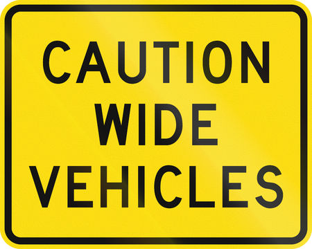 wider: New Zealand road sign - Cautioning wider vehicles to use extra caution.