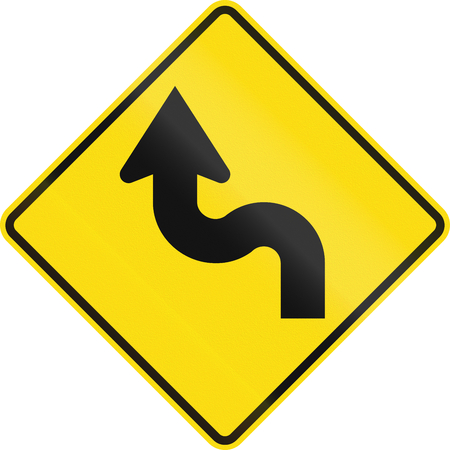 greater: New Zealand road sign - Reverse curve greater than 60 degrees, to left. Stock Photo