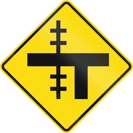 uncontrolled: New Zealand road sign - Level crossing on uncontrolled T-junction on left.