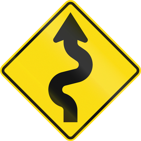 extent: New Zealand road sign - Reverse curves (less than 1km in extent) ahead, first curve to left.