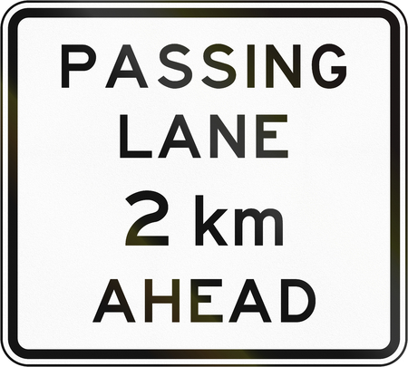 passing the road: New Zealand road sign - Passing lane ahead in 2 kilometres. Stock Photo