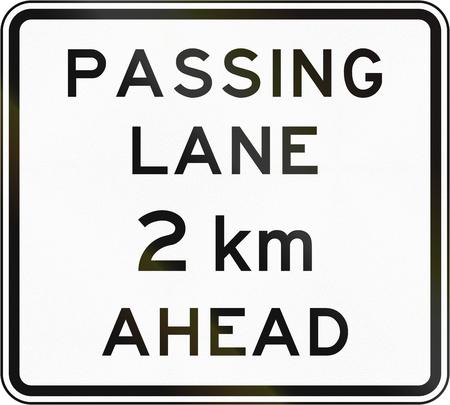 road ahead: New Zealand road sign - Passing lane ahead in 2 kilometres. Stock Photo