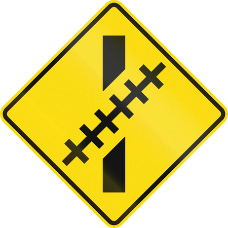 oblique: New Zealand road sign - Railway level crossing at an oblique angle. Stock Photo