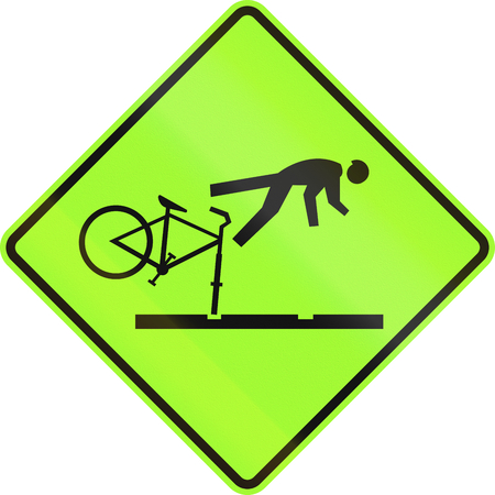 rail: New Zealand road sign - Cyclists take care on rail tracks - Fluorescent version. Stock Photo