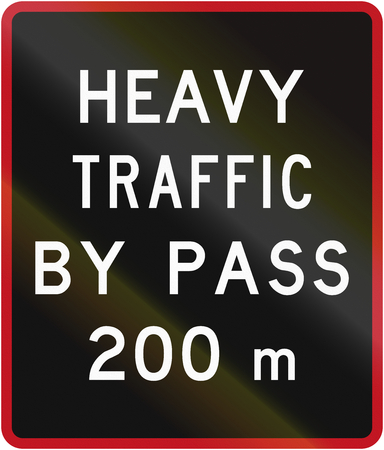Old version of the New Zealand road sign - Bypass for heavy vehicles ahead in 200 metres.