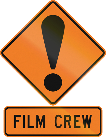 general warning: Road sign assembly in New Zealand - Film crew. Stock Photo