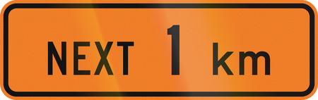 kilometre: New Zealand road sign - Road works for the next kilometre.