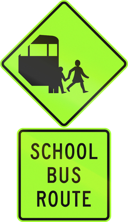 Road sign assembly in New Zealand - School bus route, fluorescent version.