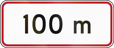 metres: New Zealand road sign RH-5 - 100 metres ahead. Stock Photo