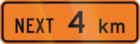kilometres: New Zealand road sign - Road works for the next 4 kilometres. Stock Photo