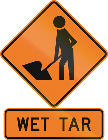 assembly language: Road sign assembly in New Zealand - Wet tar.