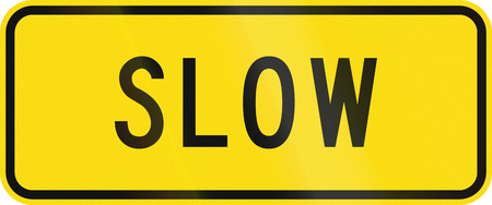 auxiliary: Advisory road sign in New Zealand warning drivers to proceed slowly.