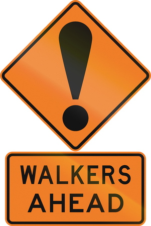Road sign assembly in New Zealand - Walkers ahead.
