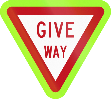 give the way: New Zealand road sign - Give Way, fluorescent version. Stock Photo