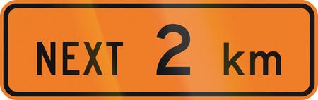 kilometres: New Zealand road sign - Road works for the next 2 kilometres.