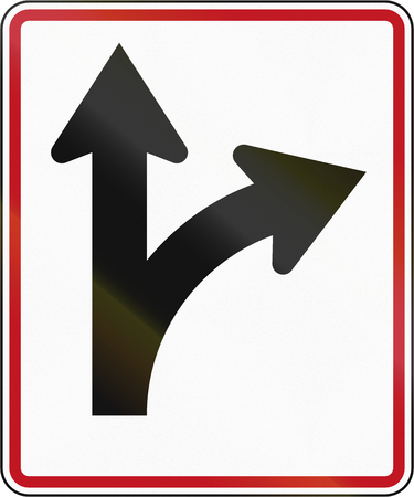 arrow sign: New Zealand road sign RG-29 - Straight ahead or right turn lane.