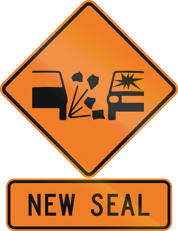 chippings: Road sign assembly in New Zealand - New seal. Stock Photo