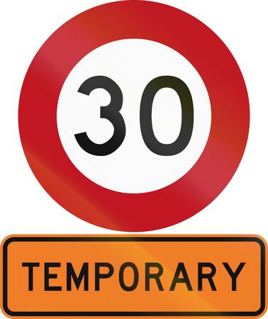 temporary: Road sign assembly in New Zealand - Temporary speed limit. Stock Photo