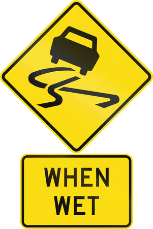 when: Road sign assembly in New Zealand - Slippery when wet.