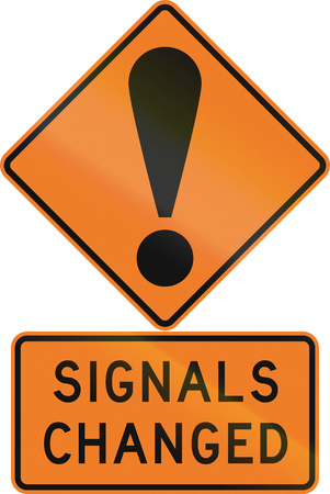 Road sign assembly in New Zealand - Signals changed. Stock Photo