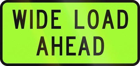 transporting: New Zealand road sign - Over-dimension vehicle transporting a extra wide load ahead.