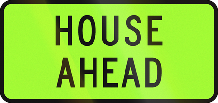 road ahead: New Zealand road sign - Over-dimension vehicle transporting a house ahead.
