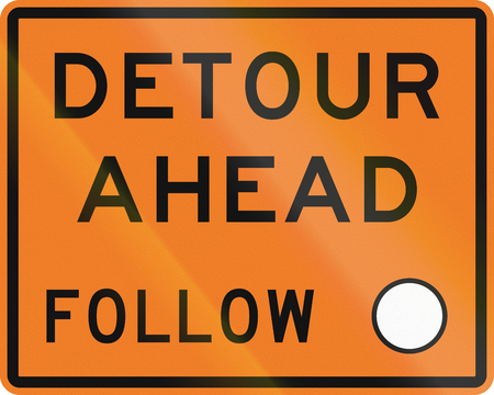 detour: New Zealand road sign - Detour ahead, follow circle symbol.