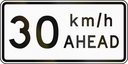 kmh: New Zealand road sign - Road works speed limit ahead, 30 kmh. Stock Photo