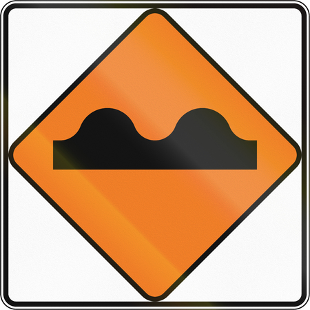 uneven: New Zealand road sign - Uneven surface. Stock Photo