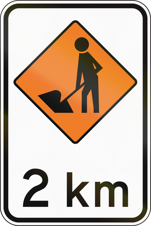 temporary workers: New Zealand road sign - Road workers ahead in 2 kilometres.