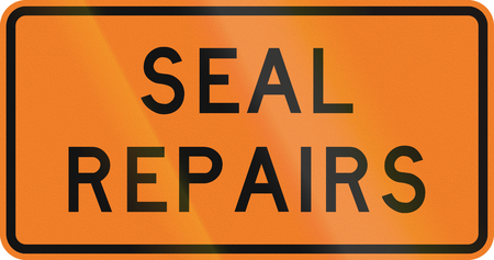 repaired: New Zealand road sign - Road seal being repaired.