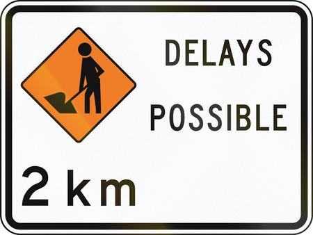 kilometres: New Zealand road sign - Road workers ahead in 2 kilometres, delays possible. Stock Photo