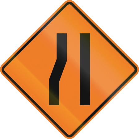 narrows: New Zealand road sign - Road narrows on left. Stock Photo