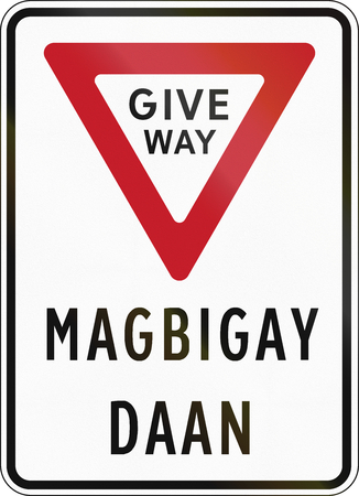 filipino: Road sign in the Philippines - Give Way in English and Filipino. Stock Photo