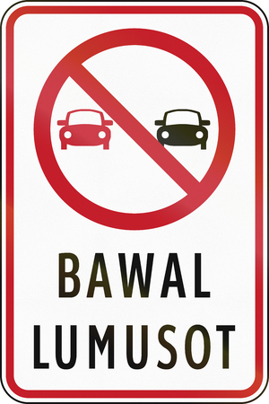 Road sign in the Philippines with Filipino words - Overtaking Prohibited.