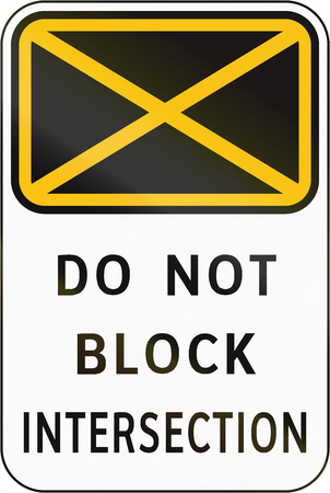 intersection: Road sign in the Philippines - Do Not Block Intersection. Stock Photo