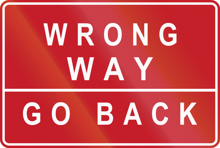 go back: Road sign in the Philippines - Wrong Way, Go Back.