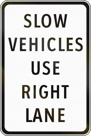 slow lane: Road sign in the Philippines - Slow Vehicles Use Right Lane.