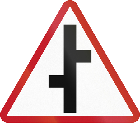 cross road: Road sign in the Philippines - Staggered Cross Road.