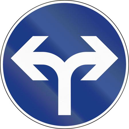 turn left sign: Slovenian mandatory direction sign - Turn left or right.