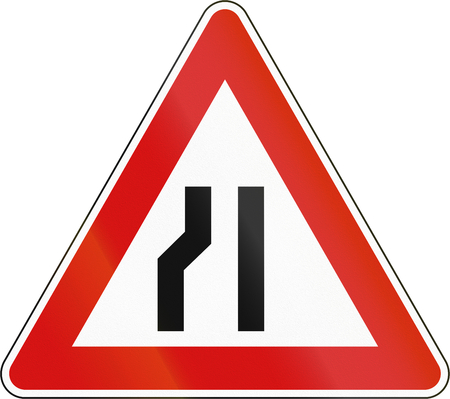 narrows: Slovenia road sign - Road narrows on the left side. Stock Photo