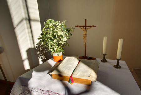bible altar: HDR shot of altar with cross and bible in a church building in Rassdorf, Hesse, Germany. Editorial