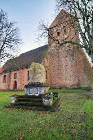 christanity: Sankt-Nikolai-Kirche (Sankt-Nikolai-Church) in Richtenberg, Mecklenburg-Vorpommern, Germany. The inscription is a bible verse. Stock Photo